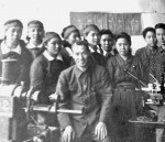 Middle sister Sachio (5th from left) with fellow workers at the Mitsubishi factory.
