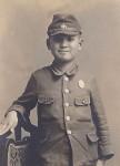 Tadashi in his school uniform